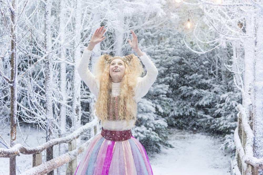 Lapland UK 2019 girl elf witth long blonde hair and rainbow pink and purple skirt