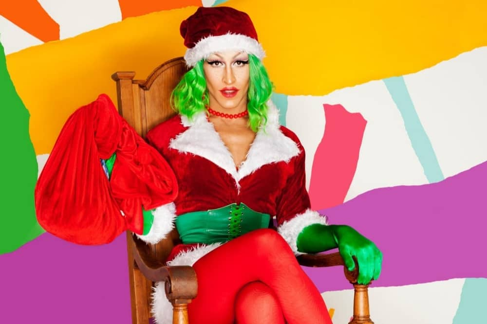 An Even More Crayola Christmas drag queen dressed as sexy santa