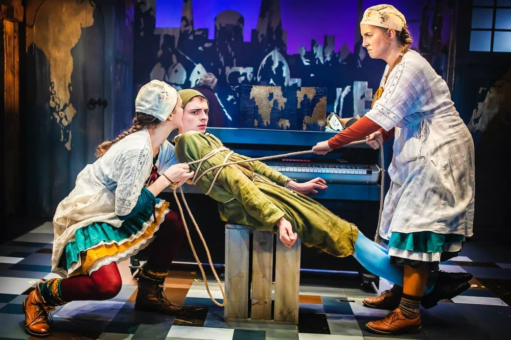The Watermill Theatre christmas show The prince and The Pauper – prince edward tied up by two sisters