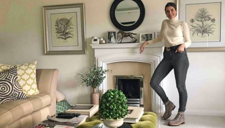 Victoria Morris Ascot woman stood by fireplace in living room
