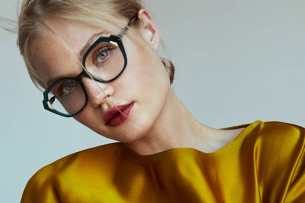 WOOW eyewear blonde woman wearing dark rimmed glasses