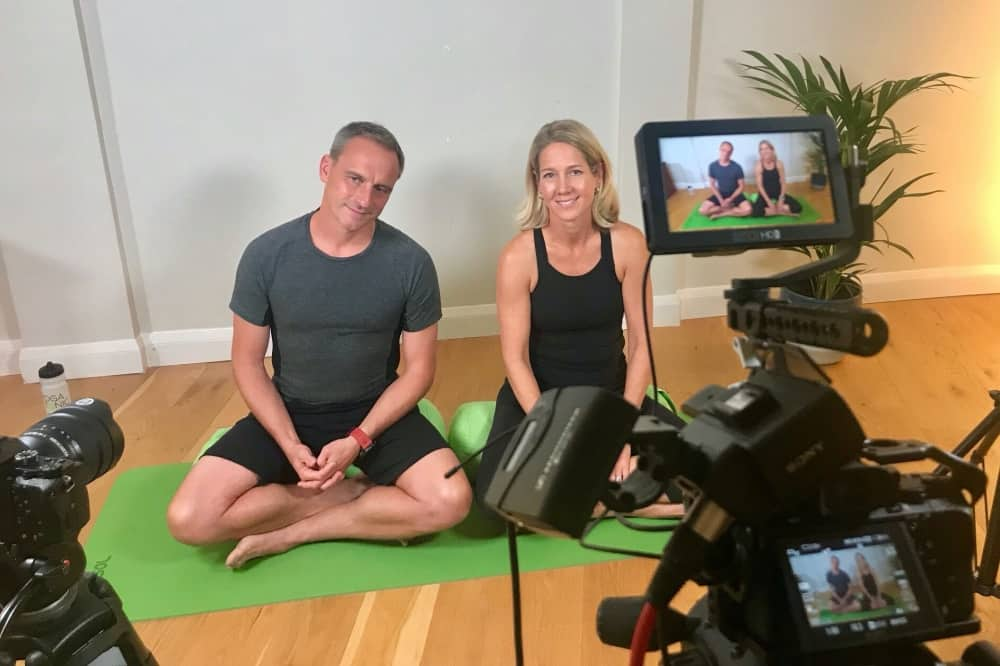 YogaTonic UK filmiing man and woman filming online yoga skifit classes