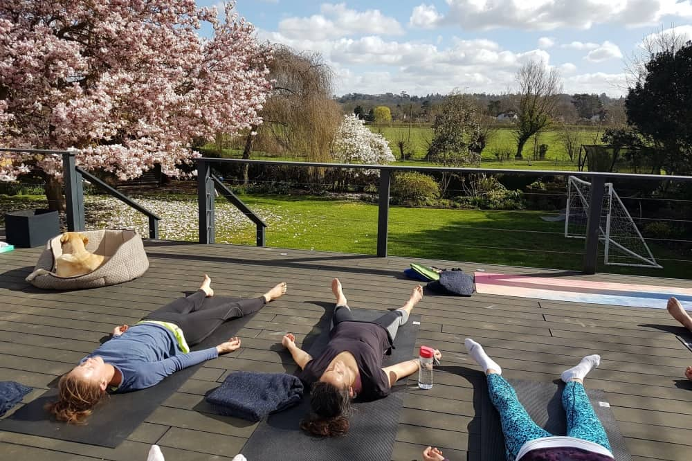 YogaTonic Uk Deck yoga outside countryside views