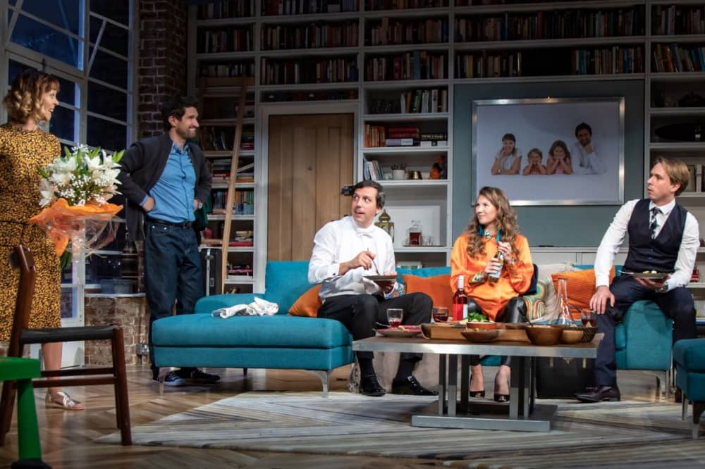 Cast of What's In A Name UK tour sat on corner sofa in loft apartment