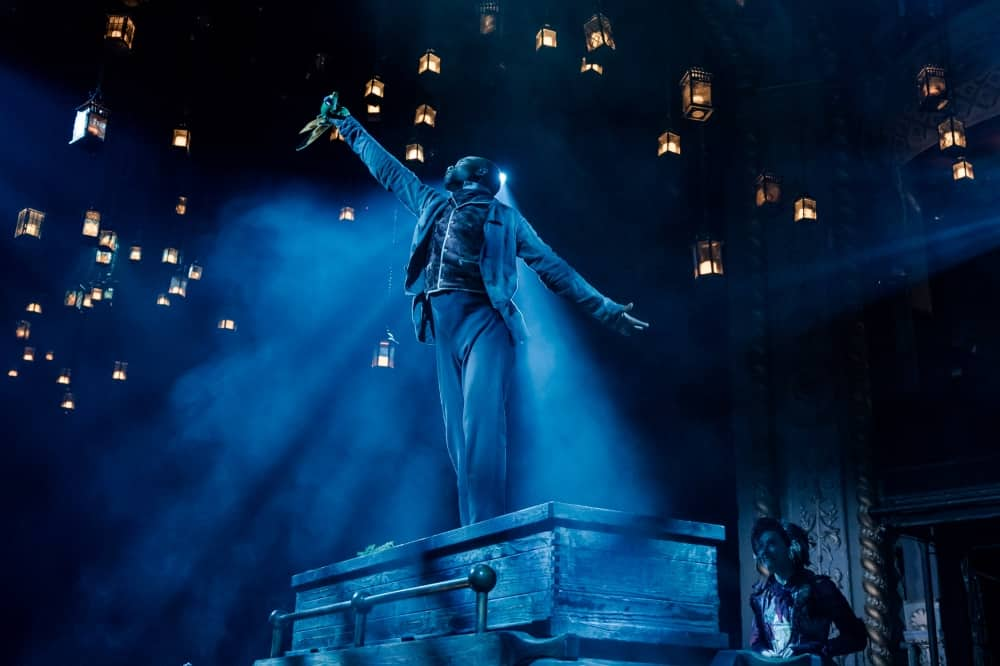 A Christmas carol old vic 2019 – man stand on wooden cart with lanterns in the sky