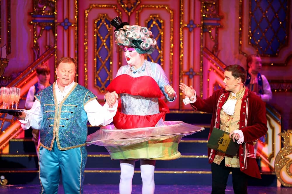 CINDERELLA ball Justin Flatcher as Button Dame Nanny C in lips dress and Dandini