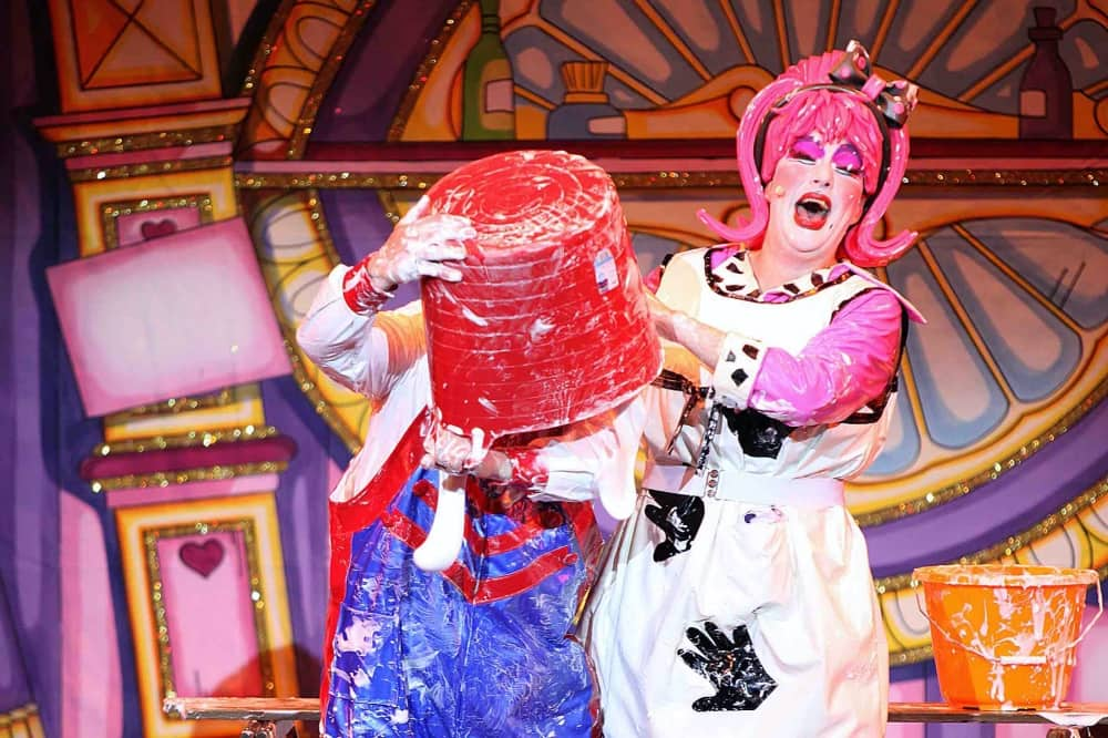 Cinderella Reading Berkshire Mr Tumble Justin Fletcher bucket on head while dame Nanny C laughS