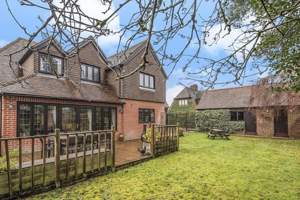 Haslams Upper Bucklebury Family home garden with deck and outbuilding