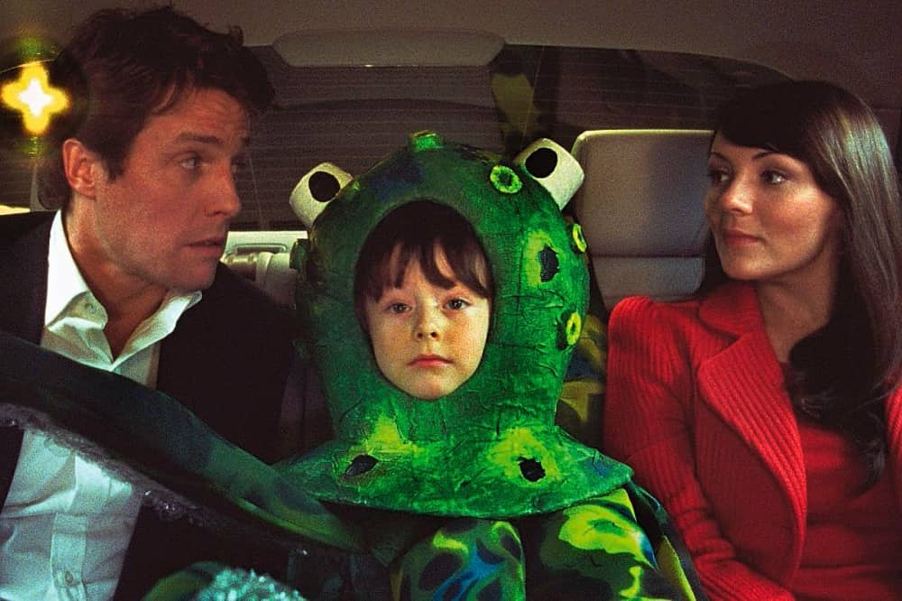 Hugh Grant and Martine McCutcheon with boy wearing octopus costume Love Actually