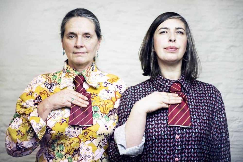 Common Salt two women hold up cut off ties