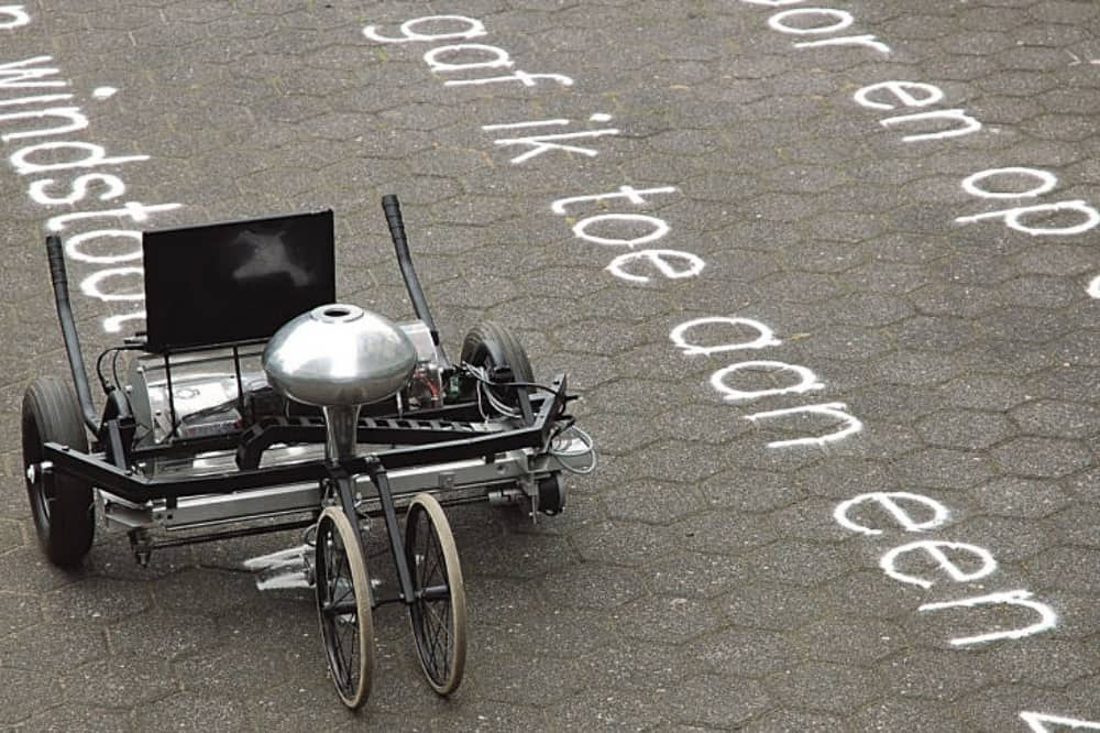 pedal machine with letters and word written on the ground