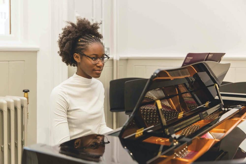 Queen Anne's School Caversham pupil playing piano