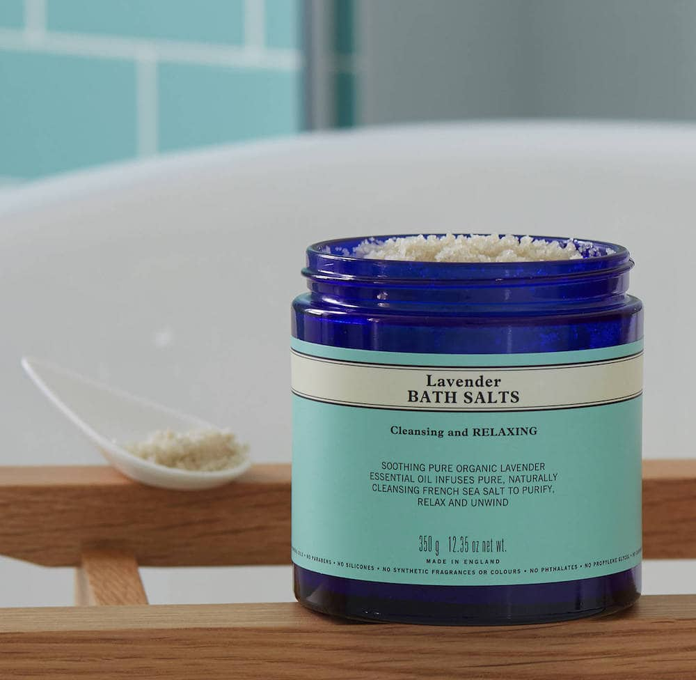 Neal's yard Lavender Bath Salts in blue glass jar