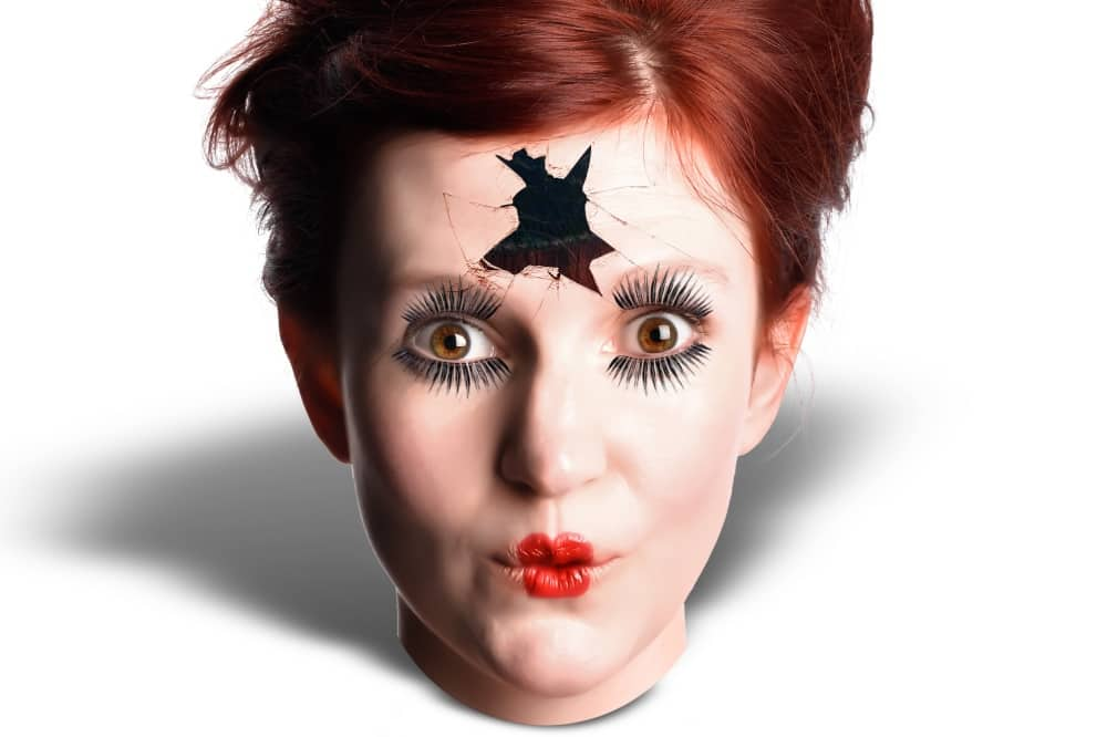 Comedian Kate Ullathorne's head with hole in the forehead like a broken doll