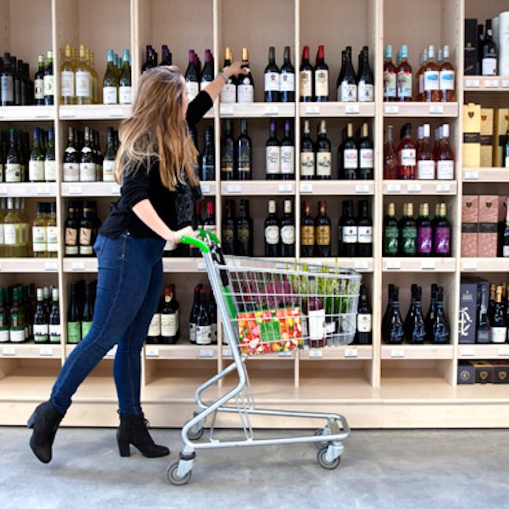 Rosebourne Aldermaston food hall woman shopping for wine