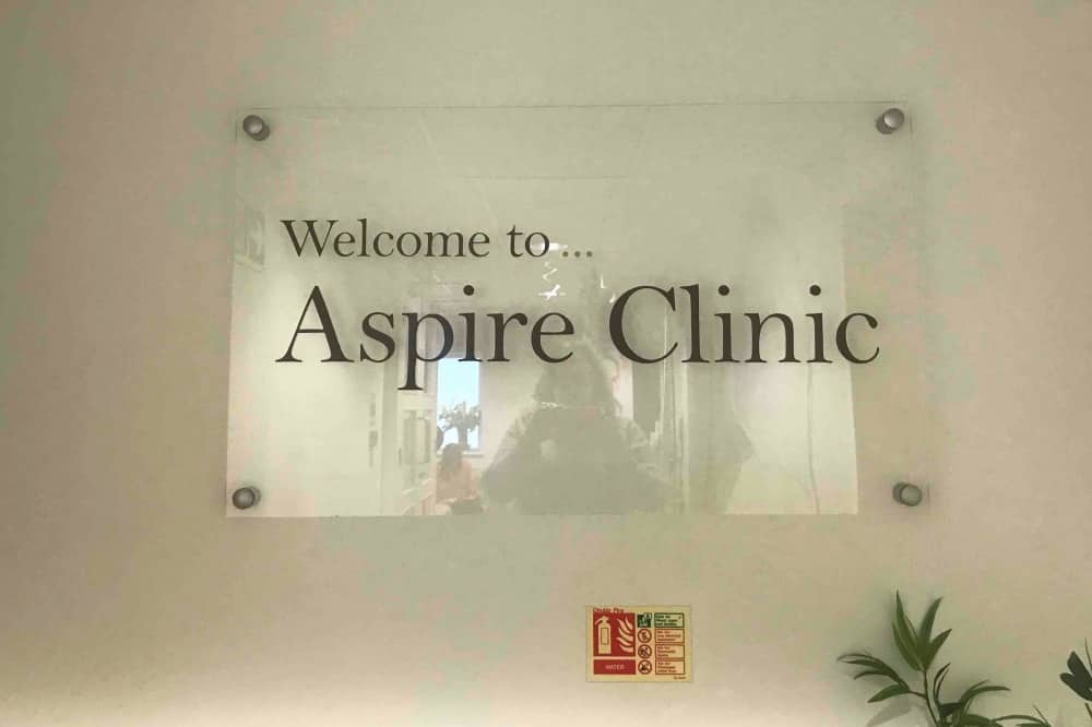 Aspire clinic sign on wall