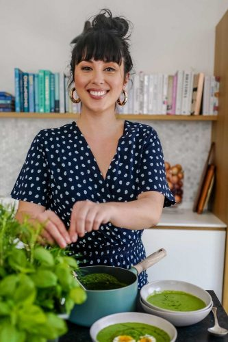 Healhty Cook Melissa-Hemsley in blue and whote spot dress picking basil