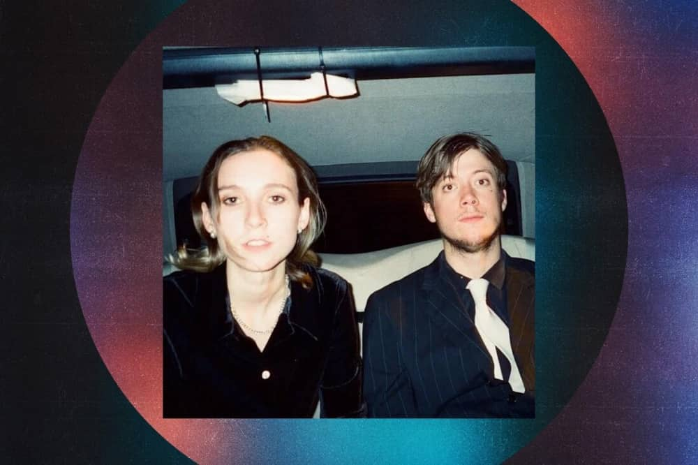 """""""One of the UK's most inventive new guitar groups"""" - Dazed and Confused Magazine """"This is a young group that doesn't want to be pinned down"""" - Pitchfork Centred around Lorenz and Louis O'Bryen, two 22-year-old childhood best friends, Sorry were signed by Domino after developing a reputation as the most thrilling new band on London's underground circuit. Sorry's lineup is completed by Lincoln Barrett on drums and bassist Campbell Baum. Sorry have not only grown into a must-see live outfit in recent years; their attention to detail across a slew of groundbreaking visual accompaniments for their early mixtapes Home Demo/ns Vol I & II and singles like 'Wished', 'Showgirl', and 'Starstruck' has earned the band their status as one of the most vital and innovative new British bands of the moment. Further details on their upcoming 2020 debut record 925 will follow around the turn of the year. A current highlight of Sorry's incendiary live shows latest single 'Right Round The Clock' saw the Domino records signed band crowned The Sunday Times' 'Breaking Act' on 10 November, with other major support coming from The Guardian Guide (Tracks of the week), DIY (Tracks of the month), The FADER (20 Best rock songs right now), Dazed (Best of October playlist) and more. 'Right Round The Clock' has also drawn national radio airplay from BBC Radio 6 Music (who playlisted the track this week), BBC Radio 1 (Jack Saunders), and Beats 1 (Matt Wilkinson). man and woman sat in back of car"""