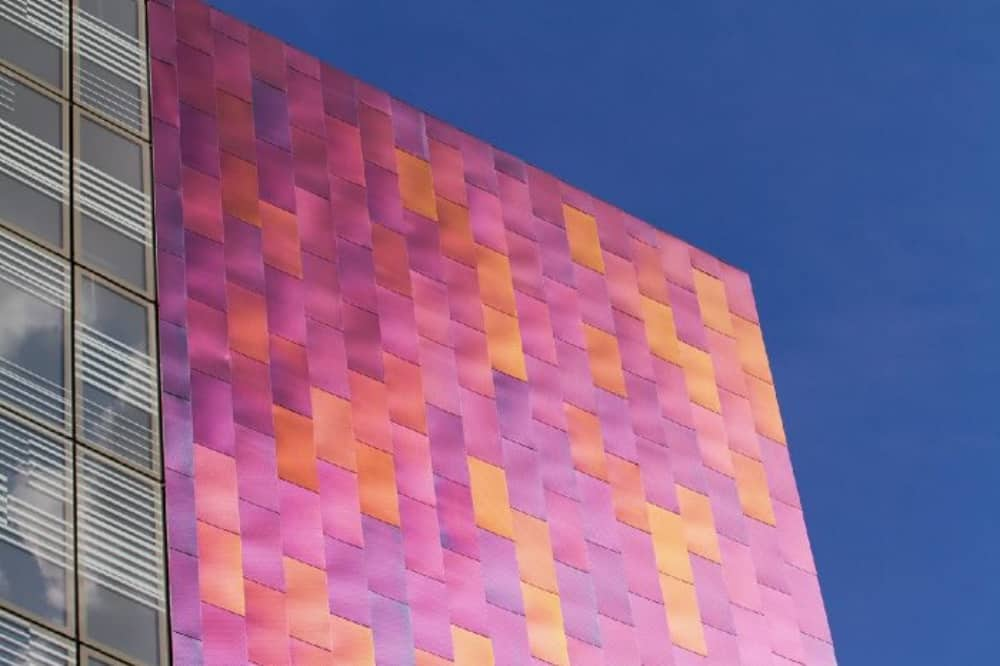 Blue sky wiith pink and orange contemporary building Splash of Colour Richard Mills