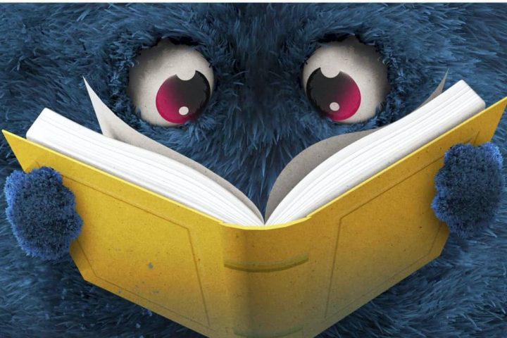 Blue monster reading a book