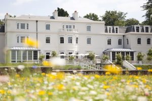 Coworth Park Ascot white georgian mansion with meadow flowers