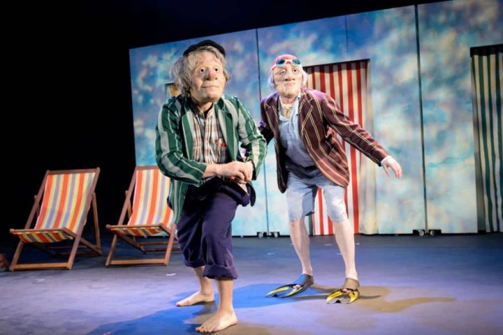 Dead Good masked actors playijng old men at the seaside