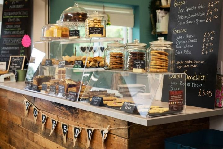 Foxes den Community Cafe Binfield rustic wooden board counter cakes cookies and blackboard menus
