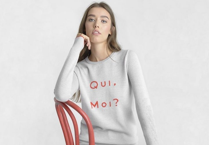 French-slogan-jumpers model wears grey sweatshirt with red 'Qui Moi?'
