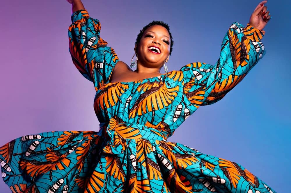 West End star and singer Marisha-Wallace wearing African print dress