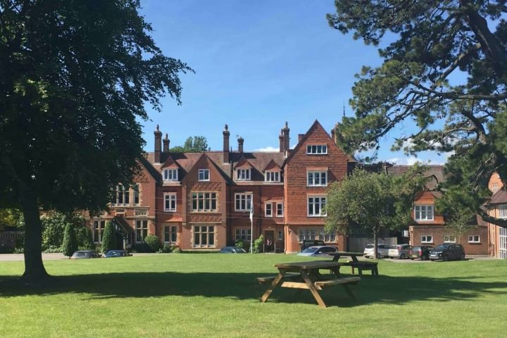 St Andrew's Prep Schol Pangbourne Berkshire exterior of red brick period mansion building and lawn