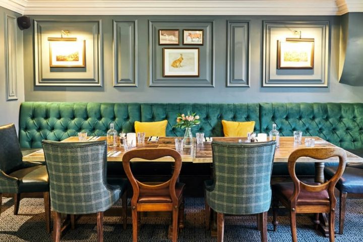 The Wellington Arms Private dining green banquette and upholdtered seats and wooden chairs