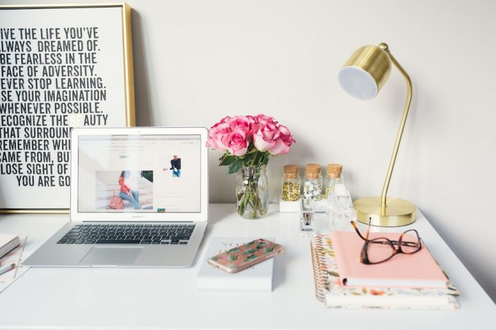 pretty-desk-laptop flowers brass lamp and cool print