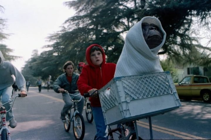 ET alien in hoody on a bike ridden by boy