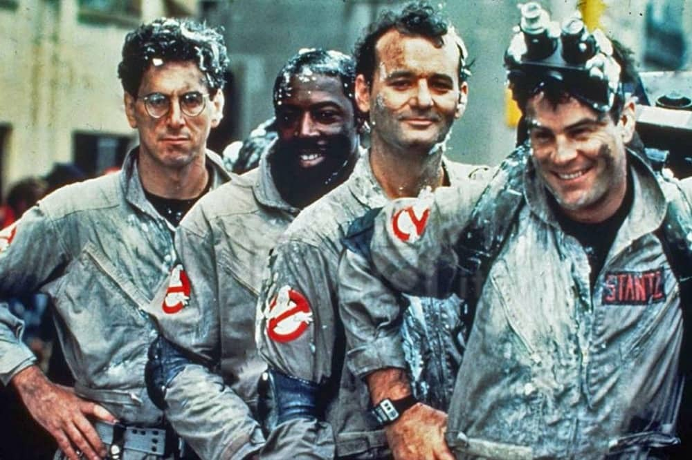 Ghostbusters; four men in boiler suits covered in the marshmallow man