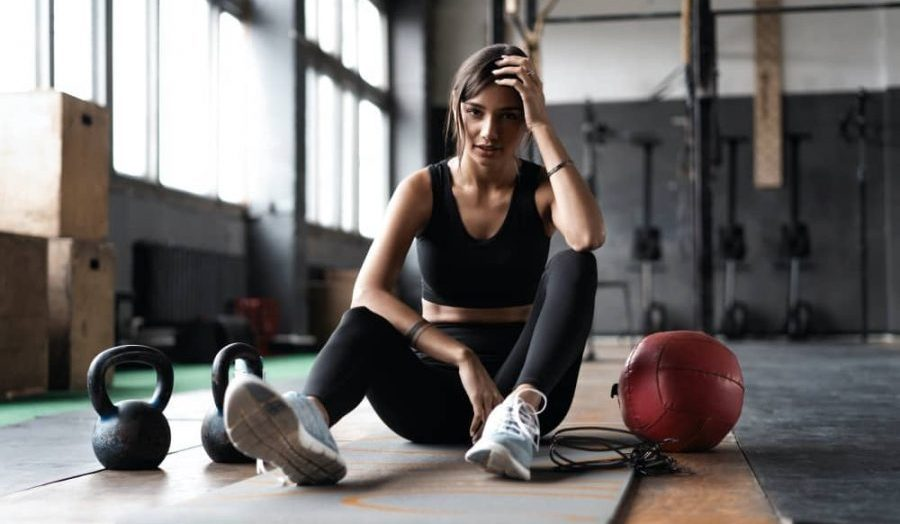 Woman on mat after gym workout