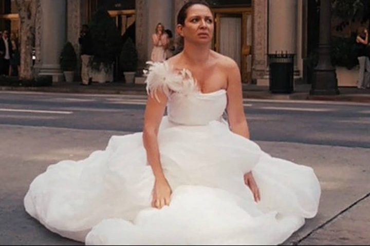 bridesmaids Bride drops to floor in the middle of the street