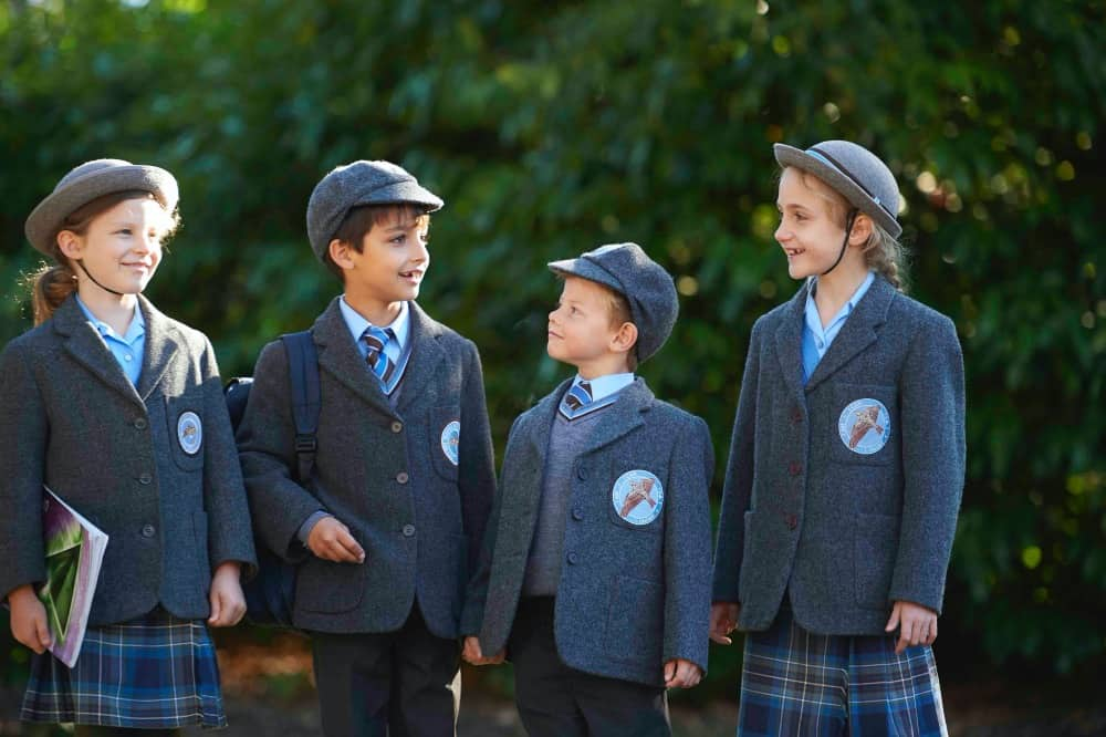 Eton End pupils in traditional caps and boater uniform