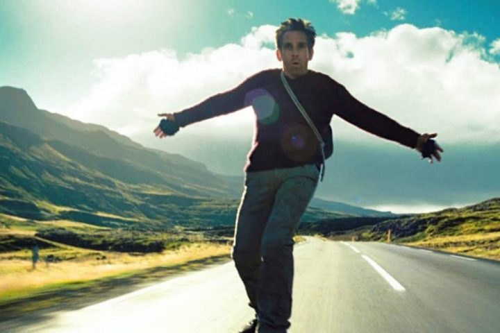 Ben Stiller as Waalter Mitty on a long boad rising idown a road
