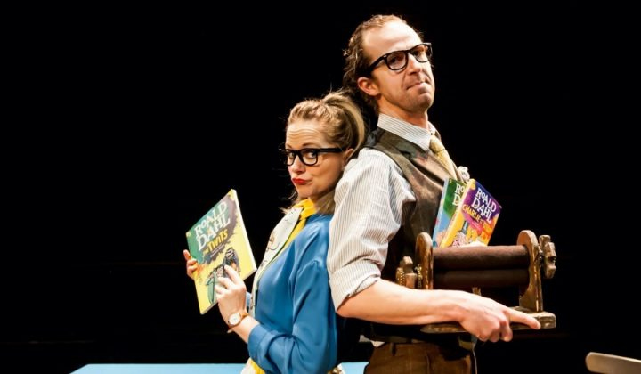 Roald Dahl and Imagination seekers man and woman holding Dahl's books on stage