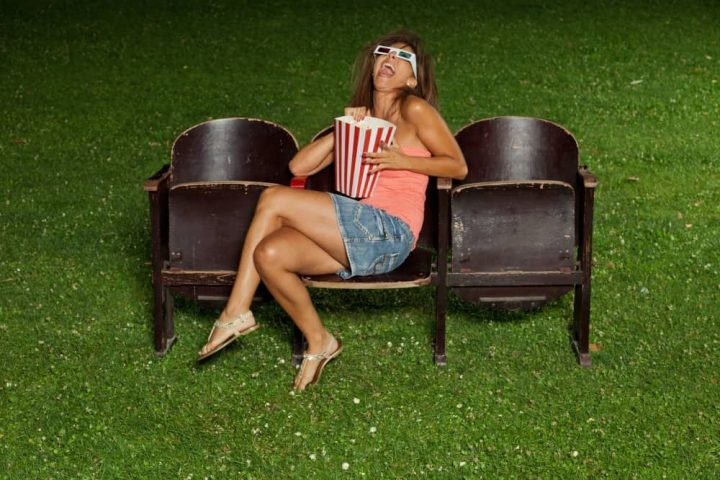Woman and popcorn outdoors