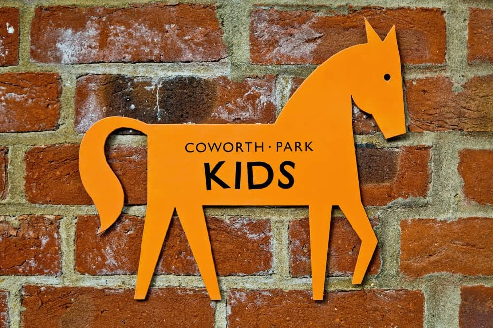 Close up of 'Coworth Park Kids' orange horse sign