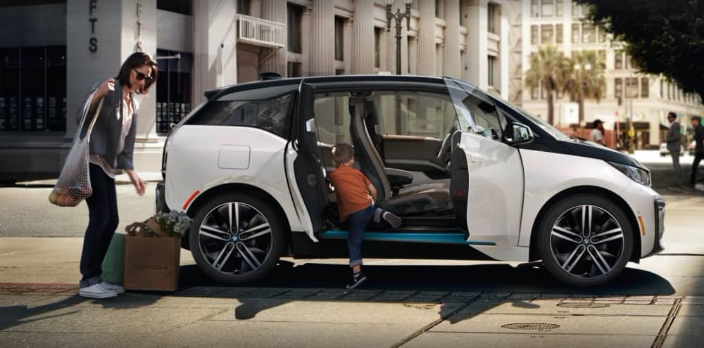 BMW i3 woman and child getting into car