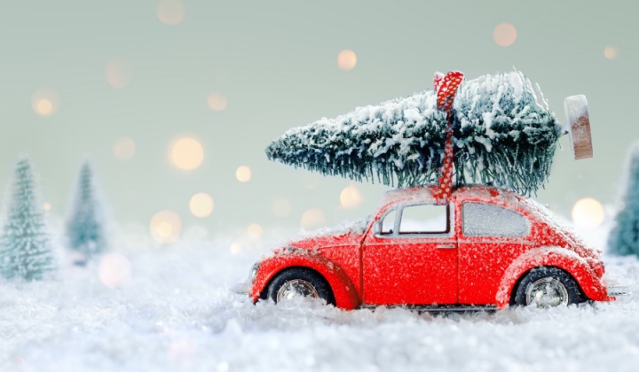 toy Red car with Christmas tree on top in snowy scene