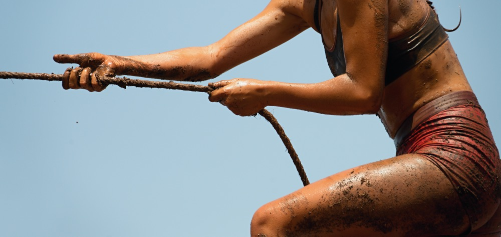 Woman on tough mudder obstacle course