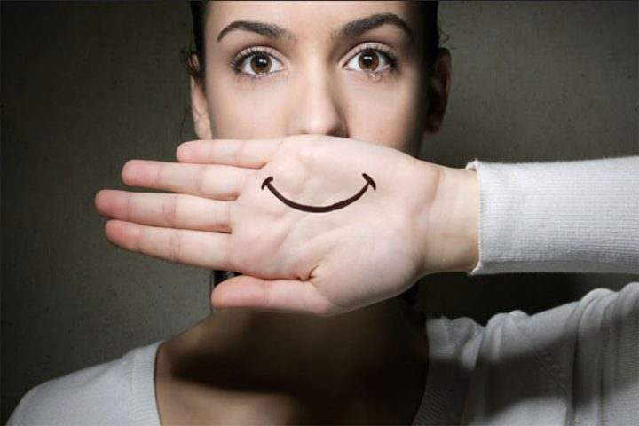 WOMAN WITH SMILE ON HAND