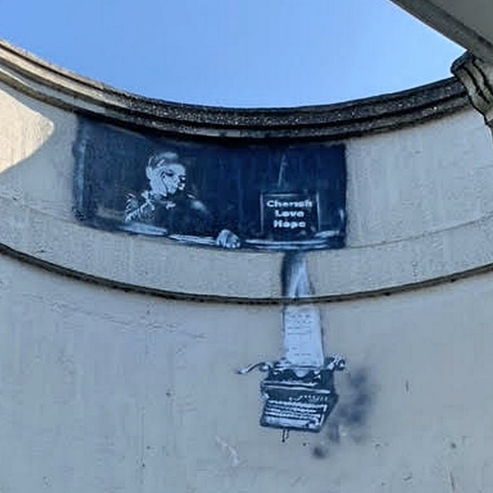 New Banksy Reading Bridge child looking down on typewriter having from knotted paper
