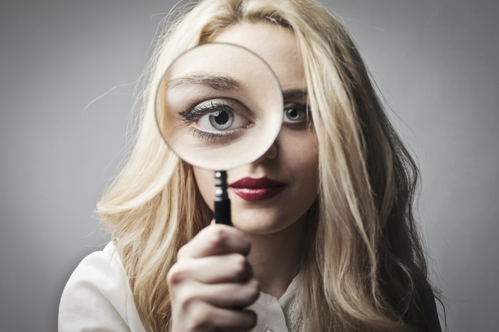 Woman face magnifying glass