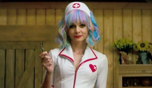 promising-young-woman_Carey Mulligan in nurses outfit holding a scalpel