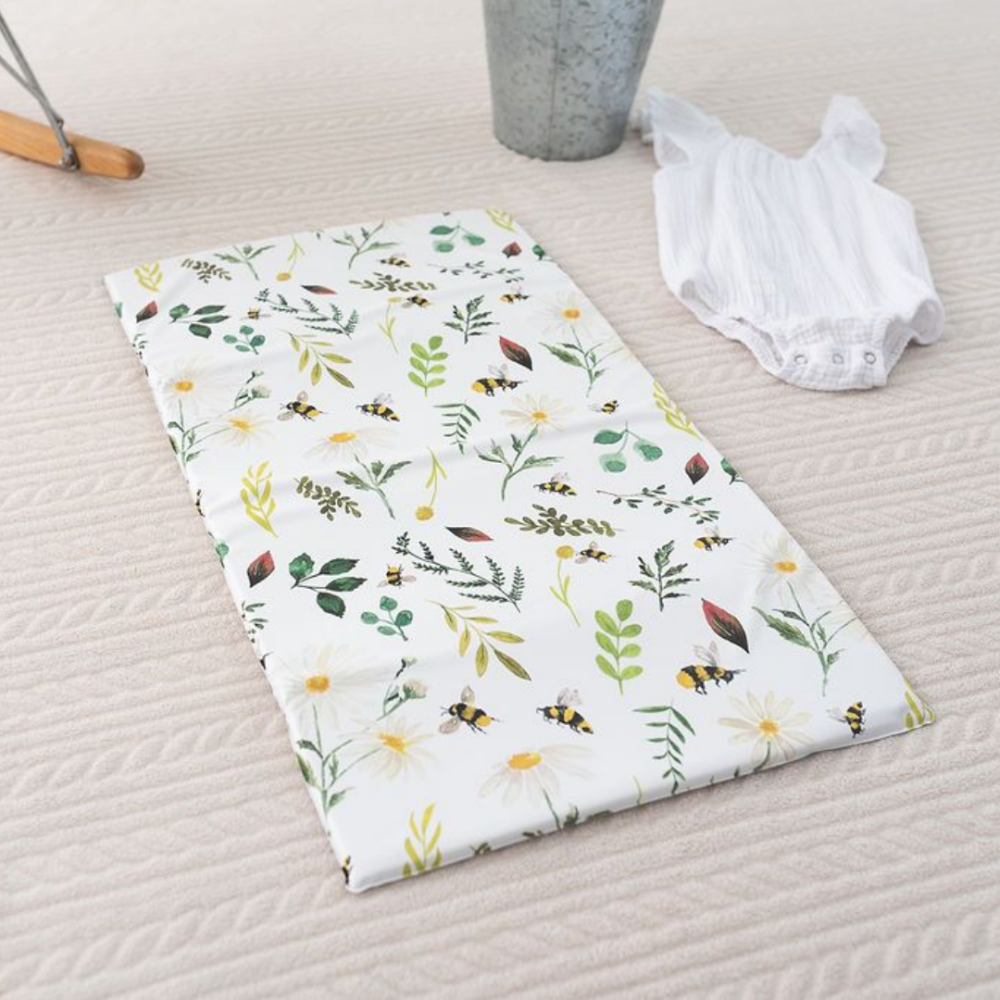 The Gilded Bird bee and flower print travel changing mat