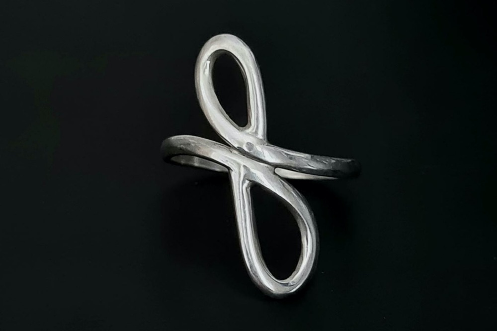 Live and Love by Maxine silver eternal swirl ring